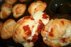This looks easy! Cut up canned biscuits, chopped pepperoni and sausage, mozarella cheese.  Roll into balls, bake at 350 for 15 mins. Dip in Pizza sauce.