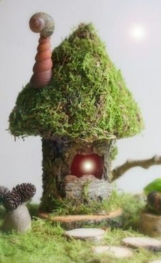 wat schattig, zon huisje van boomschors en mos. Leuk voor de herfsttafel