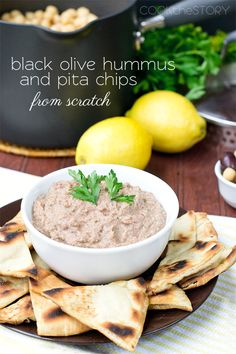 Kalamata Hummus Recipe with Homemade Pita Chips | Cook the Story - Made from scratch and served with Homemade Pita Chips that are toasted in a skillet ... so quick and easy!