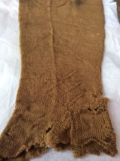 Knitted 17th Century stockings - One Wool, one silk (SILK DETAIL) - Brede, in the conservation department of the National Museum (Norway)