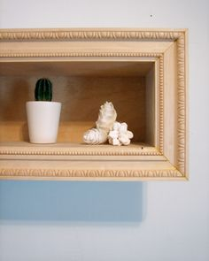 Framed shelf. Could be done with molding or old frames.