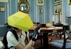 Augmented Reality Helmet: Designer Maxence Parache has created Hyper-reality, which alters the perception of our environment using an augmented reality helmet, an interactive glove, and a Kinetic system. The experience allows you to navigate through a 3D environment as if you're in an entirely new world.