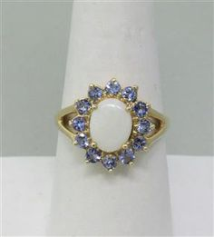14k Gold Opal Tanzanite Ring. Available @ hamptonauction.com at the Fine Jewelry Watches Coins and Collectibles Auction on November 24th, 2014! Come preview our catalog!
