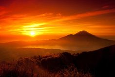 Lonely Planet's Best Sunrises | Mount Batur. 'If you're desperate for a Balinese mountain sunrise, but aren't super fit, then skip the steep, challenging Mount Agung and head for a pre-dawn clamber up nearby Mount Batur instead. Trips can be arranged from Ubud, with pick-ups starting at an upsettingly early 2am. Guides will keep you moving at a breathless pace, but the pre-dawn views across the lake to towering Agung and over the ocean to neighbouring Lombok are among SE Asia's very best.'