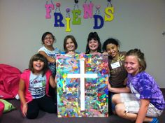 Canvas Cross Art for our classroom!  Purchased blank canvas, made a cross with duct tape, paint, then remove tape!