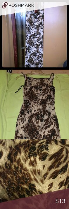 Cute womans dres Cute dress, has a bit of a shimmer to it, in like new condition, spaghetti straps, 92% polyester, 8% Spandex Dresses Midi