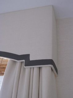 Cornice but would be a great DIY with same idea/fabrics (natural linen and gray velvet or grosgrain ribbon) translated to a padded headboard.