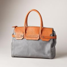 "GENOA SATCHEL -- True style is timeless, in this Italian-made leather satchel bag with its clean and elegant lines. Complete with supple leather and a soft contrasting upper. Inner zip pocket. Exclusive. Approx. 13-3/4""W x 5""D x 10-1/2""H."