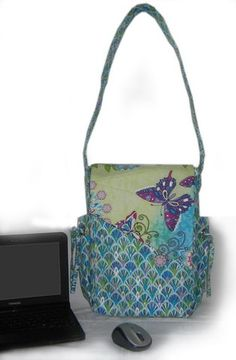 The Bevy Bag, a perfect fit for your ipad or netbook computer.  Two different linings for two different functions.