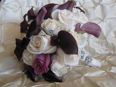 ivory roses, lavender roses and purple calla lillies & a little bling. BEAUTIFUL