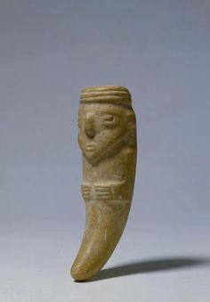 Tusk-shaped amulet  (448)    Tusk-shaped amulet. South America, Ecuador: Bahía or Guangala. 500 BC-AD 500. White stone. h. 14.8 cm. Acquired 1980. Robert and Lisa Sainsbury Collection. UEA 448. www.scva.ac.uk