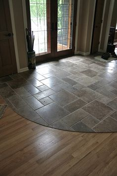I like the combination of stone near the entry (where dirty shoes can be taken off) to the wood flooring. I would use this by a main entry point to the home. Entryway Flooring, Kitchen Flooring, Wood Flooring, Flooring Ideas, Tile Entryway, Entryway Ideas, Kitchen Tiles, Floor Design, House Design