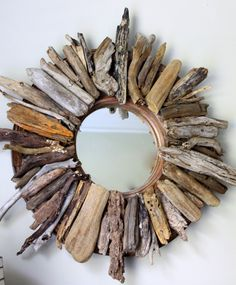 This piece is very rustic - would look great in the right place and on the right wall.....  11 Beach Inspired DIY Projects for the Home