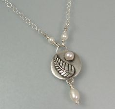 "Fern leaf and pearl sterling silver pendant necklace handcrafted from sterling silver.  ""Forest Fern Necklace"" - artisan jewelry by Kryzia Kreations  http://www.kryziakreationsstudio.com/products/fern-leaf-pendant-necklace-with-pearls   $115.00"