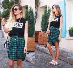 Plaids shirt worn as a skirt