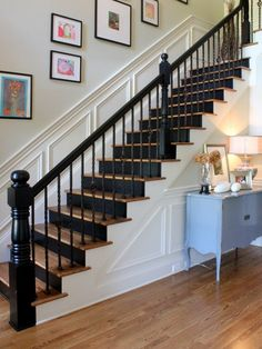Black painted wood with wrought iron railings.