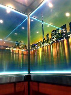 LED perimeter lighting illuminates this graphic wall print in this Elevator Interior.