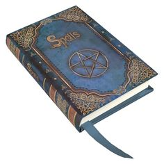 A beautiful blue Book of Spells journal featuring a pentagram with Spells written above it and other wiccan symbols around the edge. This is a quality hardcover embossed journal with finely bound full sewn sections of blank pages made of sustainable acid free forest paper, printed inside endpapers and a blue ribbon page marker. Designed by fantasy and witchcraft artist Luna Lakota. Its A7 size is perfect to fit in your handbag. A Nemesis Now product. Product Number: B0320B4