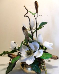 Silk floral arrangement.   Use off white flowers for a softer look.