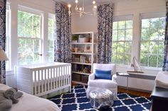 Forest fabric, royal blue and white.  Walmart crib...
