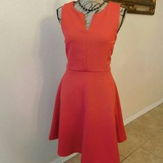 NEW gorgeous coral dress New with tags. Zipper in the back. Very flattering. 96% polyester & 2% spandex. This kind of material hides all imperfections. Cynthia Rowley Dresses