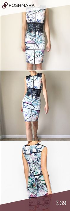 """Printed floral lace dress Beautiful printed pastel color splash. Modern romance casual date and for work. With upper back zip . 95%polyester 5%spandex . The dress fits body frame size s and M. Length : 38"""", bust : 27""""-37"""", waist: 25""""-30"""", hips: 33""""-42"""". Size L: length 39"""" bust :29""""-41"""", waist 27-31"""", hips: 35""""-47""""All measurement in inches and and flat lay relax. Preferably hand wash . No bleach . Please iron on low chicbomb Dresses Midi"""