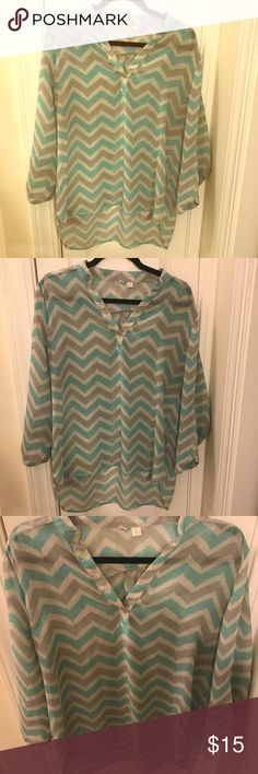 🆕EUC Francesca's blue and gray chevron blouse Great condition Francesca's gray and blue chevron blouse 3/4 sleeves sheer size Large Francesca's Collections Tops Blouses