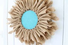 A quick and easy way to make burlap flowers for your home. Perfect for hanging in your home or adding as a wreath to your front door. Twine Flowers, Burlap Flower Wreaths, Deco Mesh Wreaths, Diy Wreath, Wreath Ideas, Spring Wreaths For Front Door Diy, Colored Burlap, Country Chic Cottage, Burlap Projects