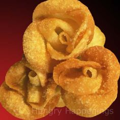 won ton roses - very cool indeed, and a MUST try   I think I will do these without the filling, then dust with powdered sugar.  and make little tasty dessert treats. YUM