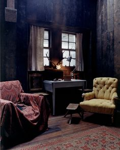 Buttoned armchair and faded floral rug, SO appealling
