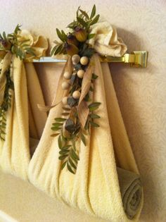 For the towel rack that you never use!  Turn it into a decorator focal point!