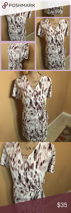 Printed Wrap Dress NWT Apt. 9 Neutral colors printed wrap dress. V-neck wrap in front. Crew neck back. Wrap style and design but it is a faux wrap and ties on the side. Short flutter sleeves. 100% polyester. Has white slip inside, v-neck, spaghetti straps. Can be removed. Polyester/Spandex blend. New with tags. Size L. Apt. 9 Dresses