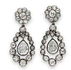 A PAIR OF ANTIQUE DIAMOND EAR PENDANTS Each suspending a bezel-set pear-shaped diamond, swinging within a graduated old mine-cut diamond frame, to the old mine-cut diamond cluster surmount, mounted in silver-topped gold, circa 1820