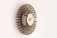 Puff wooden wall clock by GorjupDesign.Laser cut from plywood, hand assembled, glued and custom painted. The clock consists of 35 wooden parts and silent movement clock mechanism with custom painted metal hour pointers.