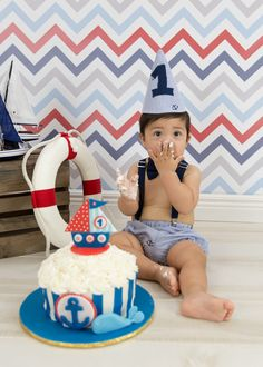 Donna Young Photography   Children First birthday, nautical theme, smash cake, one year, portrait photography, sailor, boat, life preserver, red white and blue chevron background