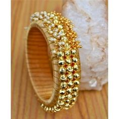 Gold silk thread bangles with pearls and ghungroos