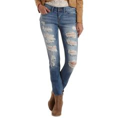 Charlotte Russe Med Wash Denim Low Rise Destroyed Skinny Jeans by... ($39) ❤ liked on Polyvore