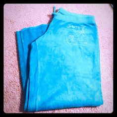 "CUTE! JUICY COUTURE Velour Size Large Lounge Pants In fantastic condition these super soft velour fabric in women's size large. Ideal lightweight  lounge pants in a gorgeous shade of light turquoise blue! Size large with a 28"" inseam. Drawstring elastic waist. Fun authentic Juicy logo on front right thigh. These are a re-posh only because they aren't long enough for my 5'11"" self!! Lol. Hate to part with them because they're the perfect weight and style for spring and summer and the color is…"