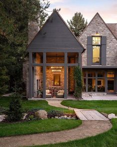 The chandelier inside creates a warm and welcoming glow that seems to invite you to step right in. #exteriors #home #homedesign Outdoor Rooms, Outdoor Living, Outdoor Areas, Exterior Design, Interior And Exterior, Exterior Homes, Dark House, Villa, Inviting Home