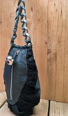 Small evening purse on black leather and eco leather by solgabriel