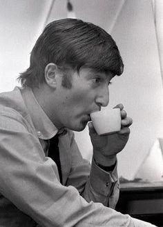 John Lennon having some tea