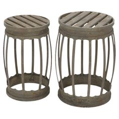 2 openwork metal stools with a barrel-inspired silhouette.  Product: Small and large barstoolConstruction Material: ...