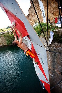 Steve McClure about to catch the last hold...or fall into the sea!
