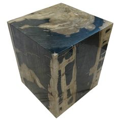 """POLISHED SQUARE PETRIFIED WOOD STOOL Dimensions 17"""" (W) x 17"""" (D) x 20"""" (H) Polished Square Petrified Wood Stool Petrified Wood Side Table offered by Organic Findings. Our Petrified Wood Tables are part of a large collection of unique objects. We combine contemporary design ideas with global product sourcing. Organic Findings sources the highest quality petrified wood, please visit our online store."""