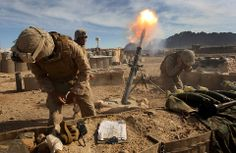 U.S. Marines fired mortars on Taliban positions in Now Zad, Afghanistan, Friday. The operation is a coordinated effort of the International Security Assistance Force. Speaking in Strasbourg, France, President Barack Obama encouraged NATO countries to commit more troops to Afghanistan. (John Moore/Getty Images)
