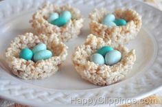 How to make edible nests: Rice Krispie treats molded into the bottom of a muffin tin to make the nest, then a little PB on top to hold the three eggs in place.