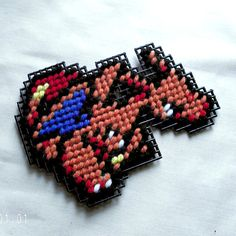 Pokemon Charizard Plastic Canvas Fridge by SnarkyLittleStitcher, $8.00