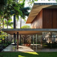 long glass house with folding wooden facade 2 patio side thumb