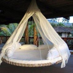 Kid trampoline made into hanging bed! Love this idea.