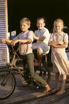 Three Amish children with a bicycle, Belize   This sure looks a lot like me and my sister an brother!